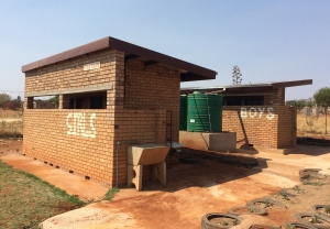 The newly constructed girls' and boys' toilets sponsored by FLSmidth through the IBASS Project